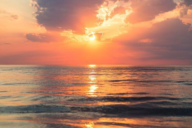 evening sunset ocean sky above clouds